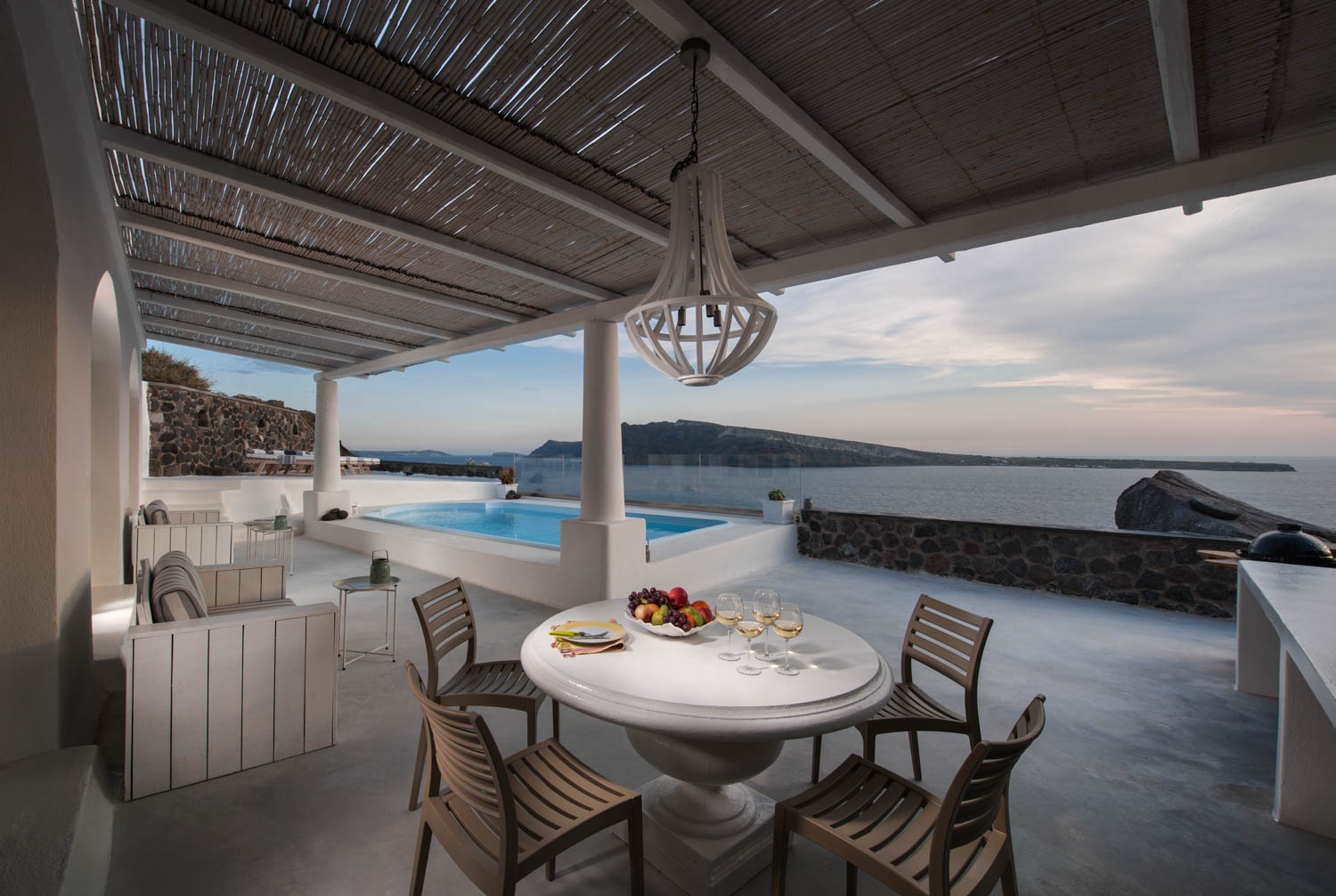 Ode Villa in Oia of Santorini outdoor dining table beside pool